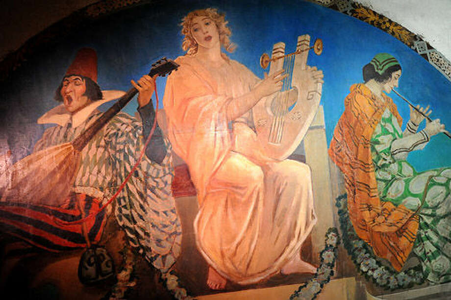 One of the murals uncovered inside the Wall Street theater that dates somewhere around the 1915-1920's era on dsiplay Sunday at the street festival celebrating the 100th anniversary of the Wall Street Theater. Hour photo/Matthew Vinci