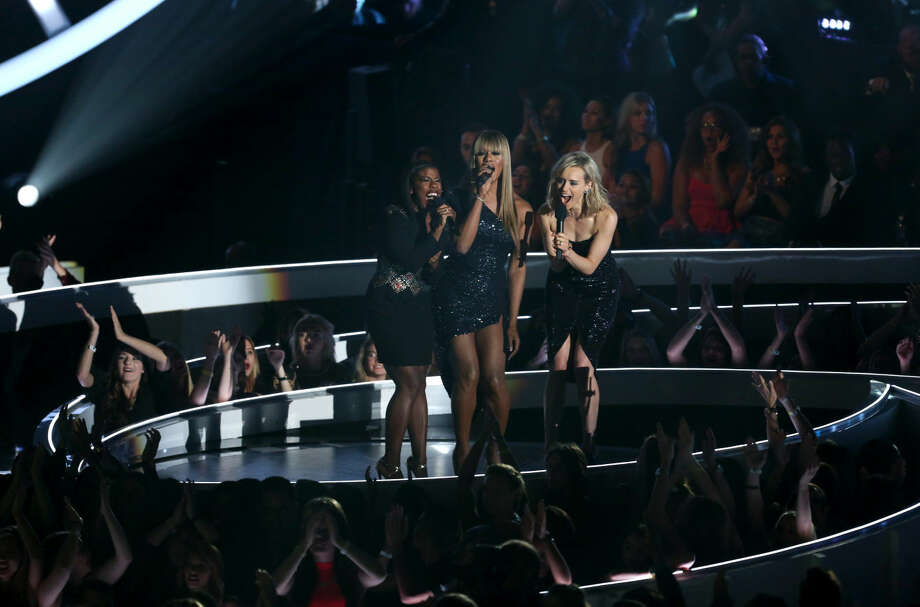 Uzo Aduba, from left, Laverne Cox and Taylor Schilling speak at the MTV Video Music Awards at The Forum on Sunday, Aug. 24, 2014, in Inglewood, Calif. (Photo by Matt Sayles/Invision/AP)