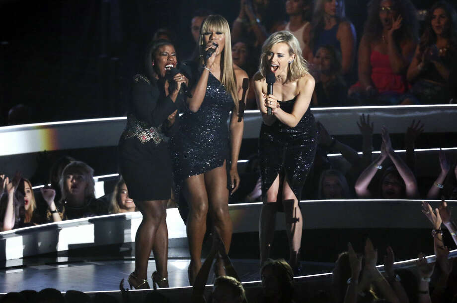 Uzo Aduba, Laverne Cox and Taylor Schilling speak at the MTV Video Music Awards at The Forum on Sunday, Aug. 24, 2014, in Inglewood, Calif. (Photo by Matt Sayles/Invision/AP)