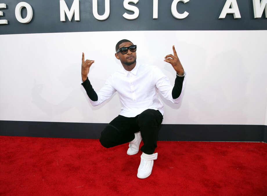 Usher arrives at the MTV Video Music Awards at The Forum on Sunday, Aug. 24, 2014, in Inglewood, Calif. (Photo by Matt Sayles/Invision/AP)