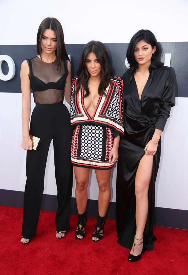 Kendall Jenner, from left, Kim Kardashian, and Kylie Jenner arrive at the MTV Video Music Awards at The Forum on Sunday, Aug. 24, 2014, in Inglewood, Calif. (Photo by Matt Sayles/Invision/AP)