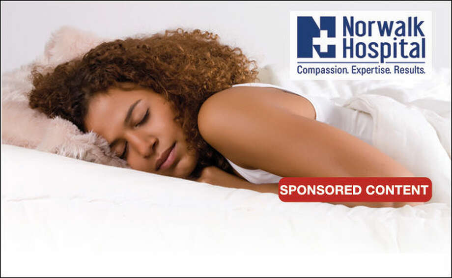 Cute african girl is falling a sleep in her bed
