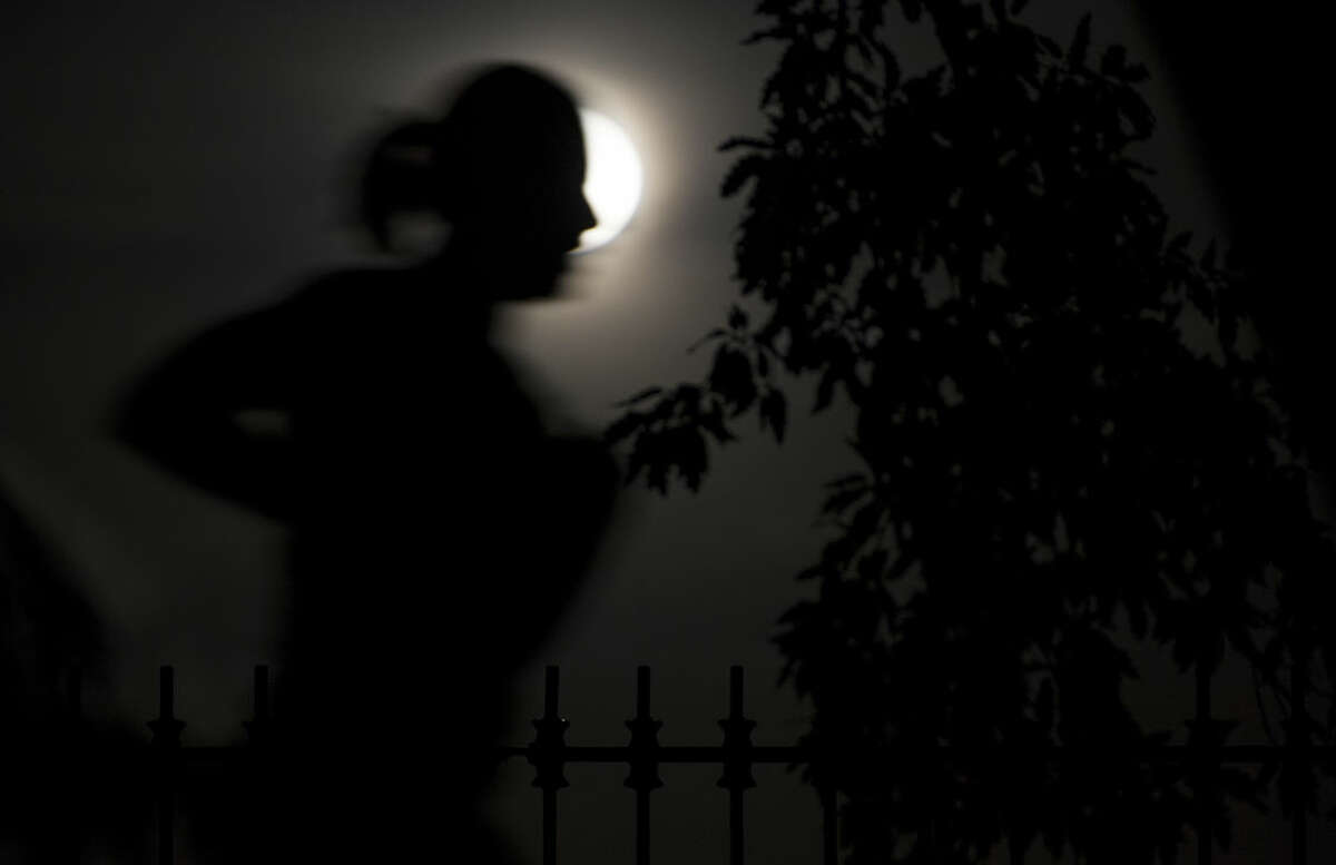 In this photo provided by NASA, a person runs as a so-called supermoon rises above Central Park in New York, Sunday, Sept. 27, 2015. The combination of the supermoon and total lunar eclipse on Sunday last occurred in 1982 and will not happen again until 2033. (Joel Kowsky/NASA via AP) MANDATORY CREDIT
