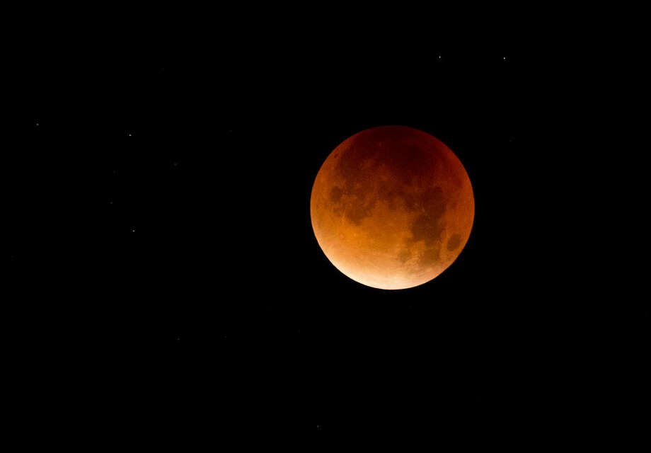 A so-called supermoon is seen at the start of a lunar eclipse above Lisbon in the early hours of Monday, Sept. 28, 2015. Supermoon, or perigee moon, is the name given when the full or new moon comes closest to the Earth making it appear bigger. (AP Photo/Armando Franca)