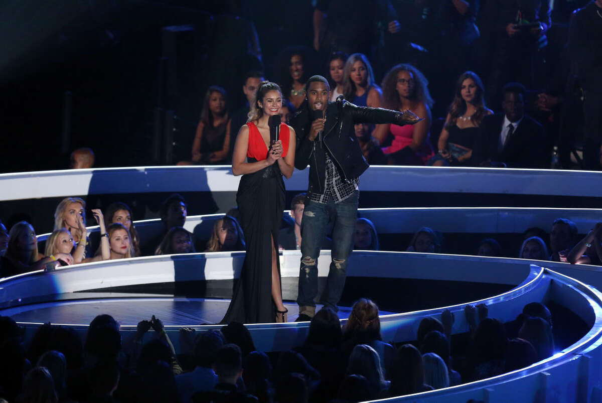 Nina Dobrev, left, and Trey Songz present the award for Best Rock Video at the MTV Video Music Awards at The Forum on Sunday, Aug. 24, 2014, in Inglewood, Calif. (Photo by Matt Sayles/Invision/AP)