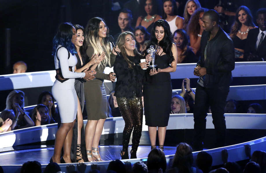 Normani Hamilton, from left, Camila Cabello, Dinah Jane Hansen, Ally Brooke and Lauren Jauregui of Fifth Harmony accept the award for Artist to Watch at the MTV Video Music Awards at The Forum on Sunday, Aug. 24, 2014, in Inglewood, Calif. (Photo by Matt Sayles/Invision/AP)