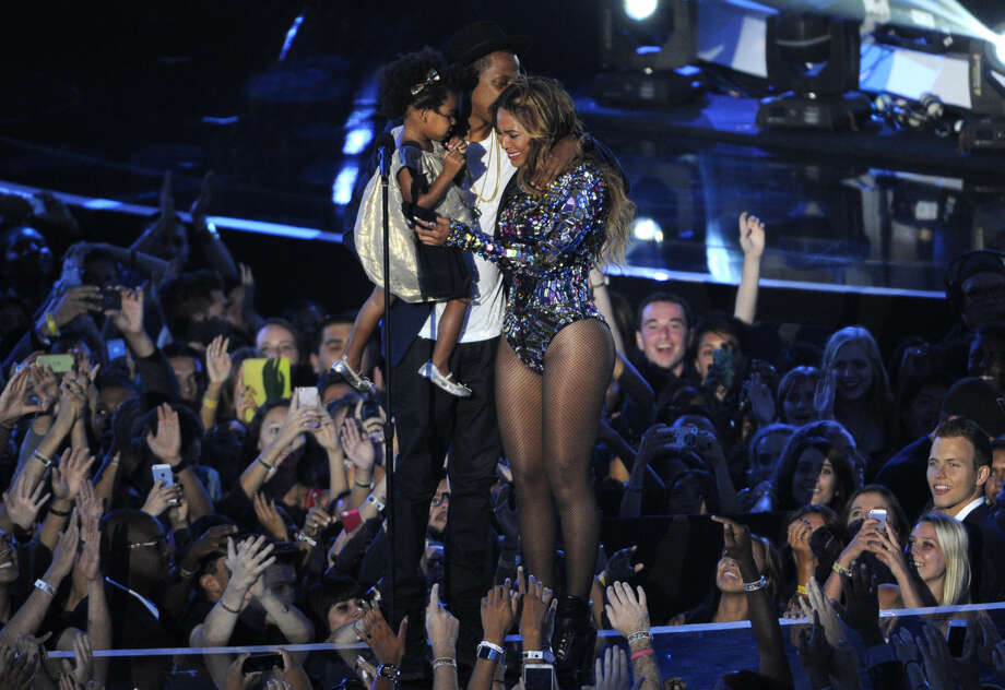 Beyonce on stage with Jay Z and their daughter Blue Ivy as she accepts the Video Vanguard Award at the MTV Video Music Awards at The Forum on Sunday, Aug. 24, 2014, in Inglewood, Calif. (Photo by Chris Pizzello/Invision/AP)