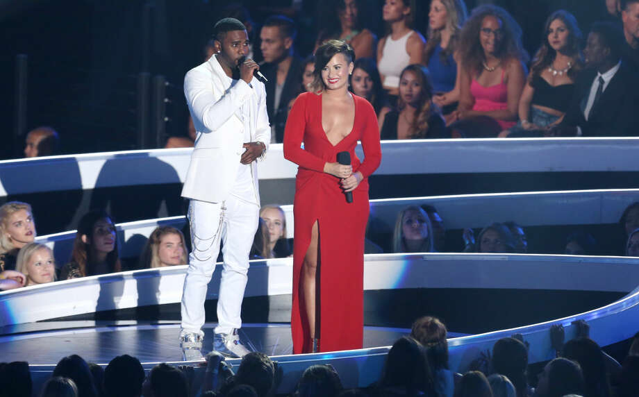 Jason Derulo, left, and Demi Lovato speak at the MTV Video Music Awards at The Forum on Sunday, Aug. 24, 2014, in Inglewood, Calif. (Photo by Matt Sayles/Invision/AP)