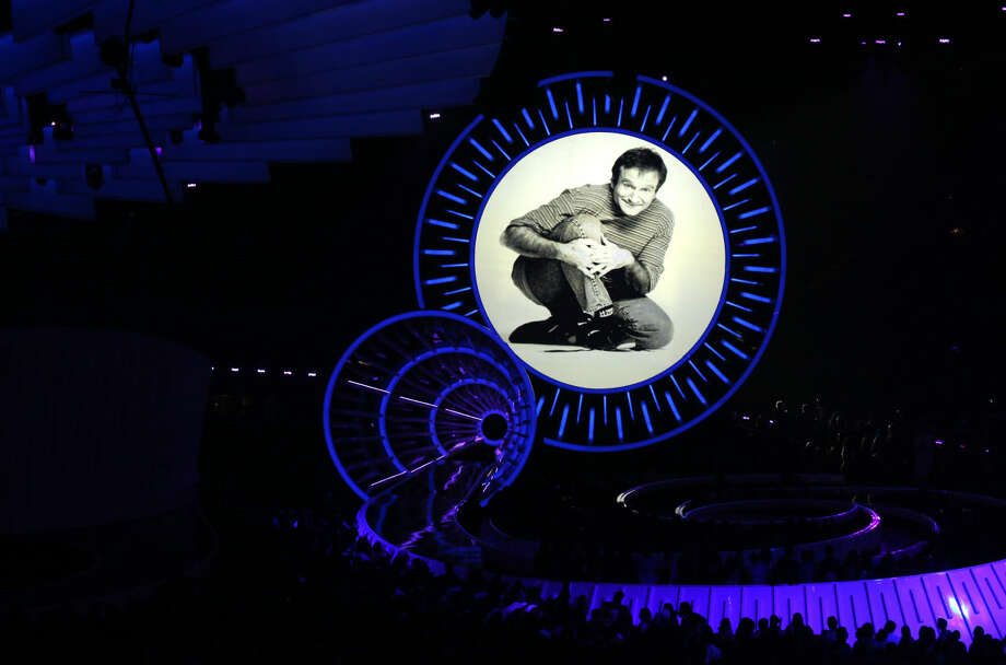 Robin Williams tribute appears on screen at the MTV Video Music Awards at The Forum on Sunday, Aug. 24, 2014, in Inglewood, Calif. (Photo by Matt Sayles/Invision/AP)