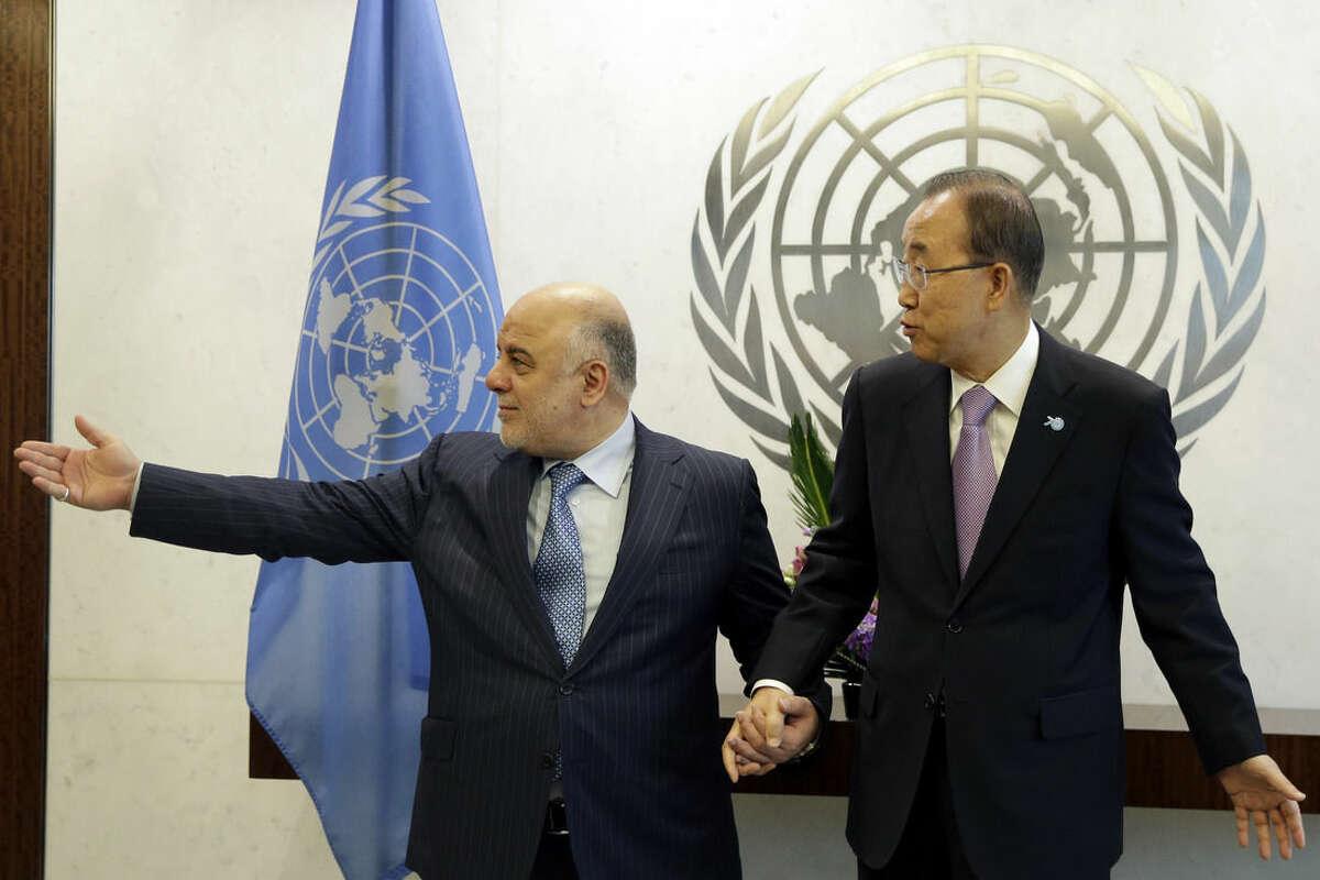 United Nations Secretary-General Ban Ki-moon, right, meets Iraqi Prime Minister Haider Al Abadi, at U.N. Headquarters, Wednesday, Sept. 30, 2015. (AP Photo/Mary Altaffer)