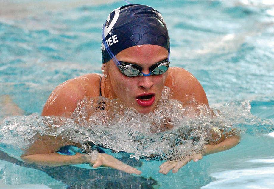 Hour photo / Erik Trautmann Wilton high School girls swimming takes on the Norwalk/McMahon Co-op team at the Wilton YMCA Wednesday.