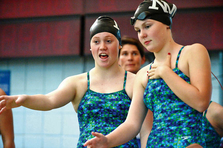 Hour photo / Erik Trautmann Wilton high School girls swimming takes on the Norwalk/McMahon Co-op team at the Wilton YMCA Wednesday.