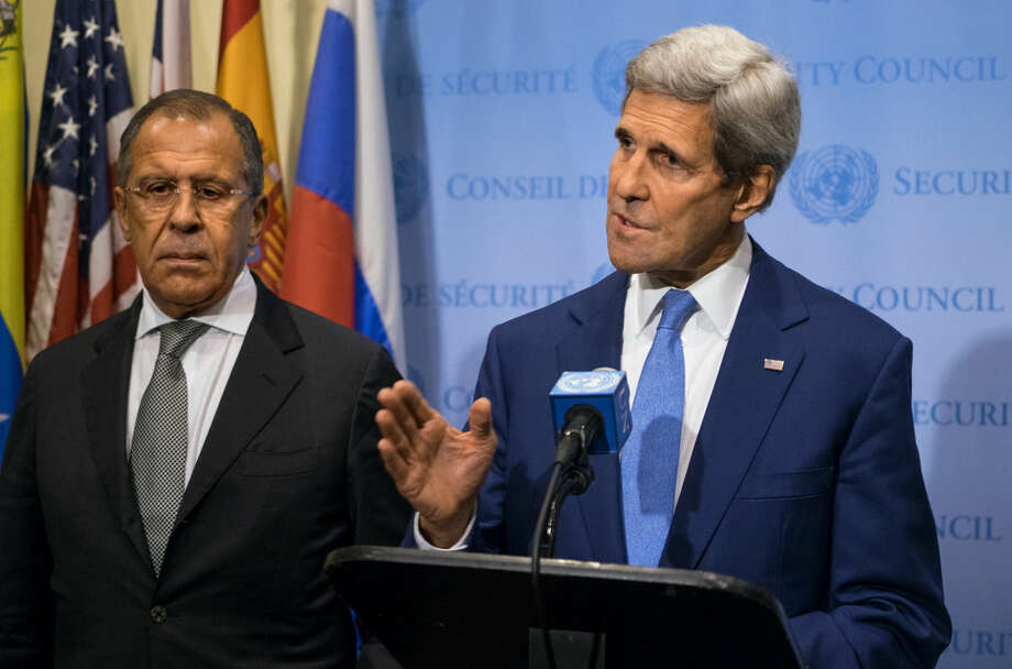 U.S. Secretary of State John Kerry, right, speaks next to Russia's Foreign Minister Sergey Lavrov during a news conference at the U.N., Wednesday, Sept. 30, 2015. (AP Photo/Craig Ruttle)