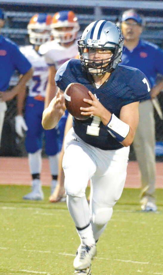 Staples' Andrew Speed runs the ball against Danbury in the Wreckers' 21-14 win on Sept. 19. (Pete Paguaga/Hour photo)