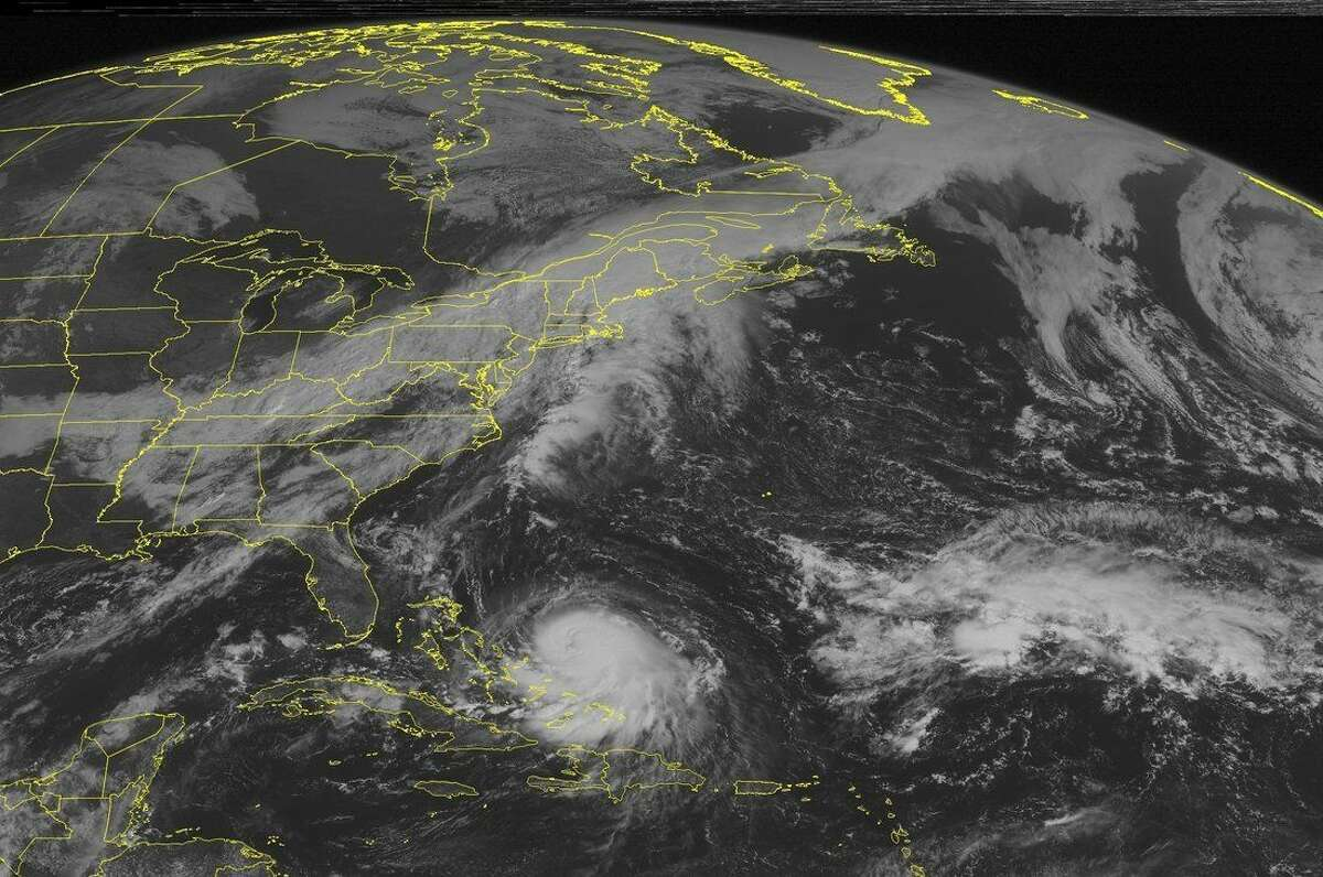 This NOAA satellite image taken Wednesday, Sept. 30, 2015, at 9:45 AM EDT shows a cold front stretching from the Northeast into the central US. A long the front is a developing low pressure over New England. This is producing heavy rain and thunderstorms. Behind the storm system is an are of high pressure, producing clear skies for the Northern Plains. In the Caribbean region is Hurricane Joaquin. The storm is expected to start heading north and could possibly effect the east coast later in the week. (Weather Underground via AP)