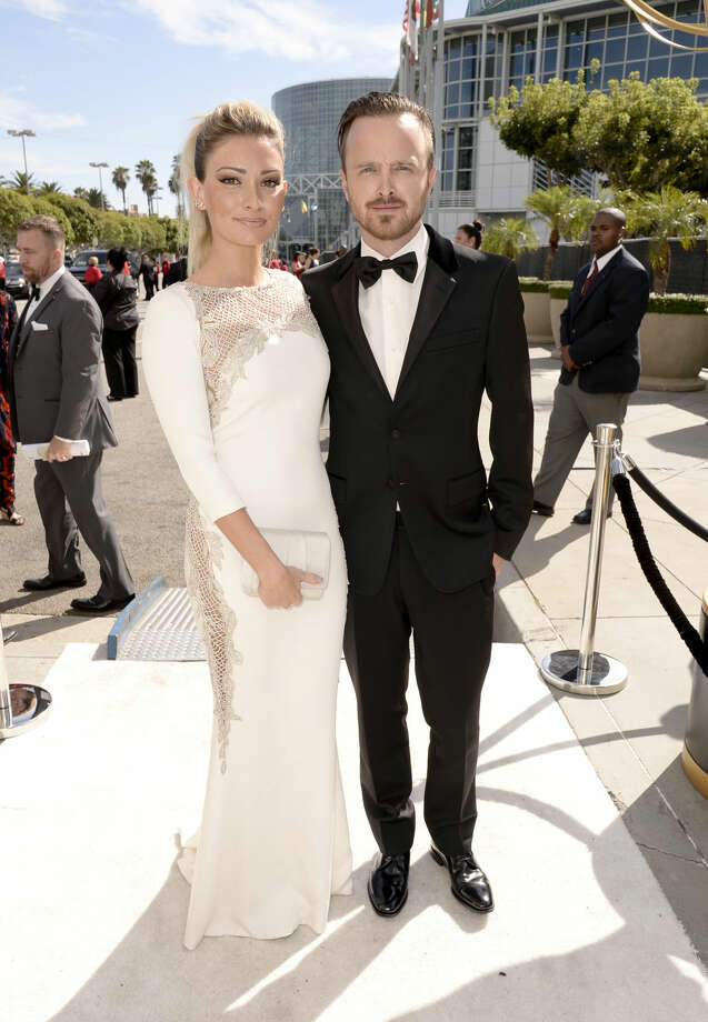 IMAGE DISTRIBUTED FOR THE TELEVISION ACADEMY - Lauren Parsekian, left, and Aaron Paul arrive at the 66th Primetime Emmy Awards at the Nokia Theatre L.A. Live on Monday, Aug. 25, 2014, in Los Angeles. (Photo by Dan Steinberg/Invision for the Television Academy/AP Images)