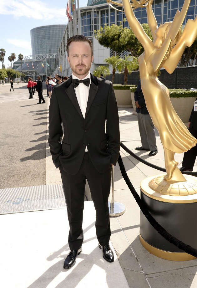 IMAGE DISTRIBUTED FOR THE TELEVISION ACADEMY - Aaron Paul arrives at the 66th Primetime Emmy Awards at the Nokia Theatre L.A. Live on Monday, Aug. 25, 2014, in Los Angeles. (Photo by Dan Steinberg/Invision for the Television Academy/AP Images)