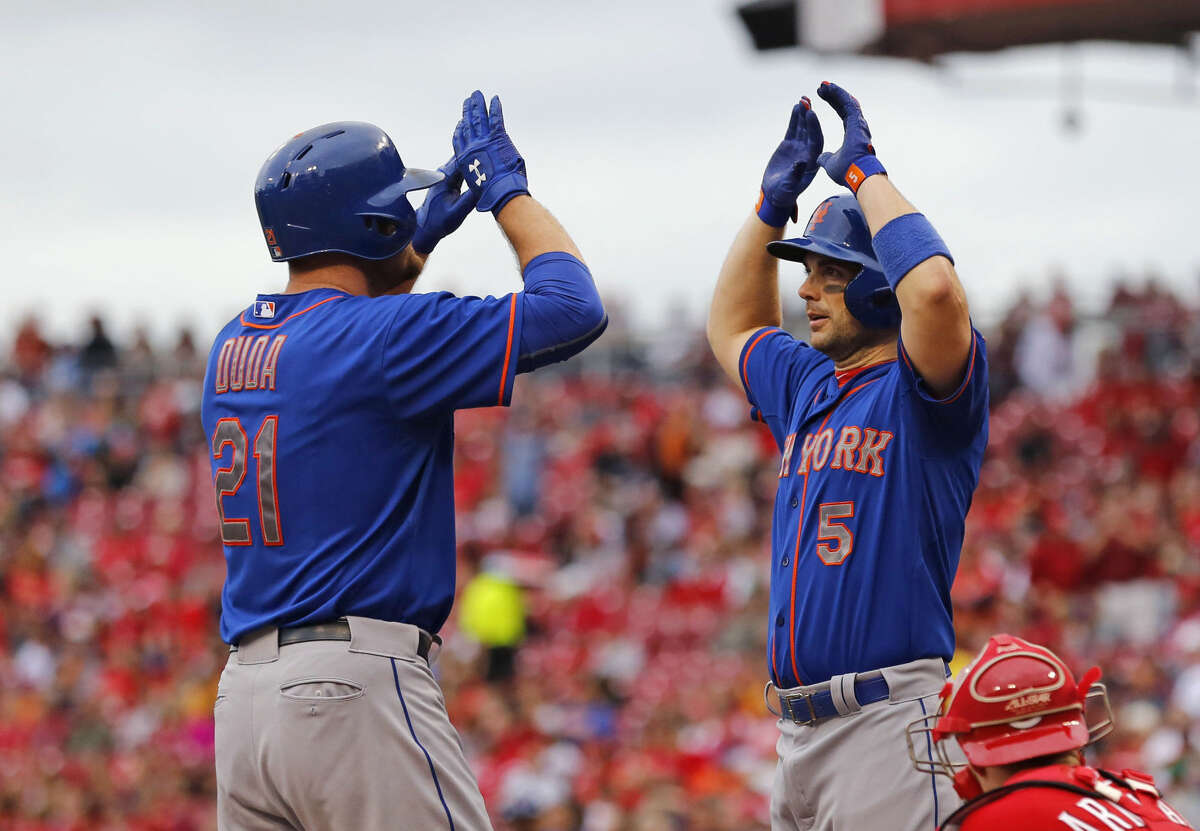 New York Mets' Lucas Duda (21) celebrates with David Wright (5) after hitting a grand slam in the first inning of a baseball game against the Cincinnati Reds, Saturday, Sept. 26, 2015, in Cincinnati. (AP Photo/Aaron Doster)
