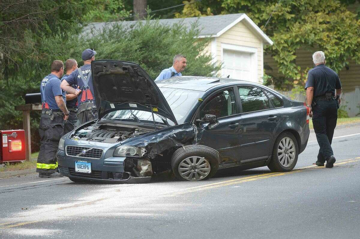 Hour Photo/Alex von Kleydorff a Volvo sedan sits on New Canaan Ave closing the street Tuesday morning, one of two vehicles involved in accidents near Lloyd Rd