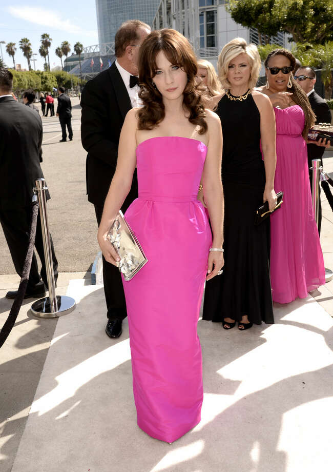 IMAGE DISTRIBUTED FOR THE TELEVISION ACADEMY - Zooey Deschanel arrives at the 66th Primetime Emmy Awards at the Nokia Theatre L.A. Live on Monday, Aug. 25, 2014, in Los Angeles. (Photo by Dan Steinberg/Invision for the Television Academy/AP Images)