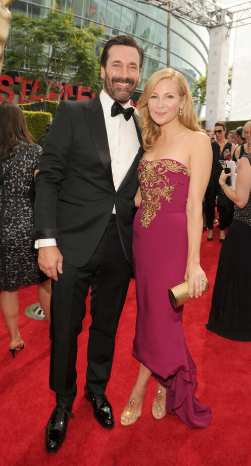 IMAGE DISTRIBUTED FOR THE TELEVISION ACADEMY - Actor Jon Hamm, left, and actress Jennifer Westfeldt arrive at the 66th Primetime Emmy Awards at the Nokia Theatre L.A. Live on Monday, Aug. 25, 2014, in Los Angeles. (Photo by Frank Micelotta/Invision for the Television Academy/AP Images)