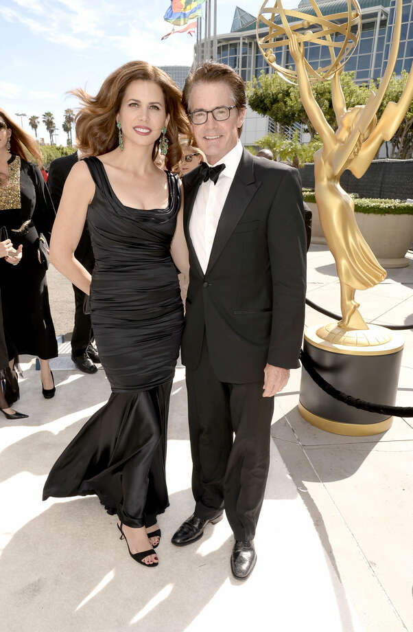 IMAGE DISTRIBUTED FOR THE TELEVISION ACADEMY - Desiree Gruber, left, and Kyle MacLachlan arrive at the 66th Primetime Emmy Awards at the Nokia Theatre L.A. Live on Monday, Aug. 25, 2014, in Los Angeles. (Photo by Dan Steinberg/Invision for the Television Academy/AP Images)