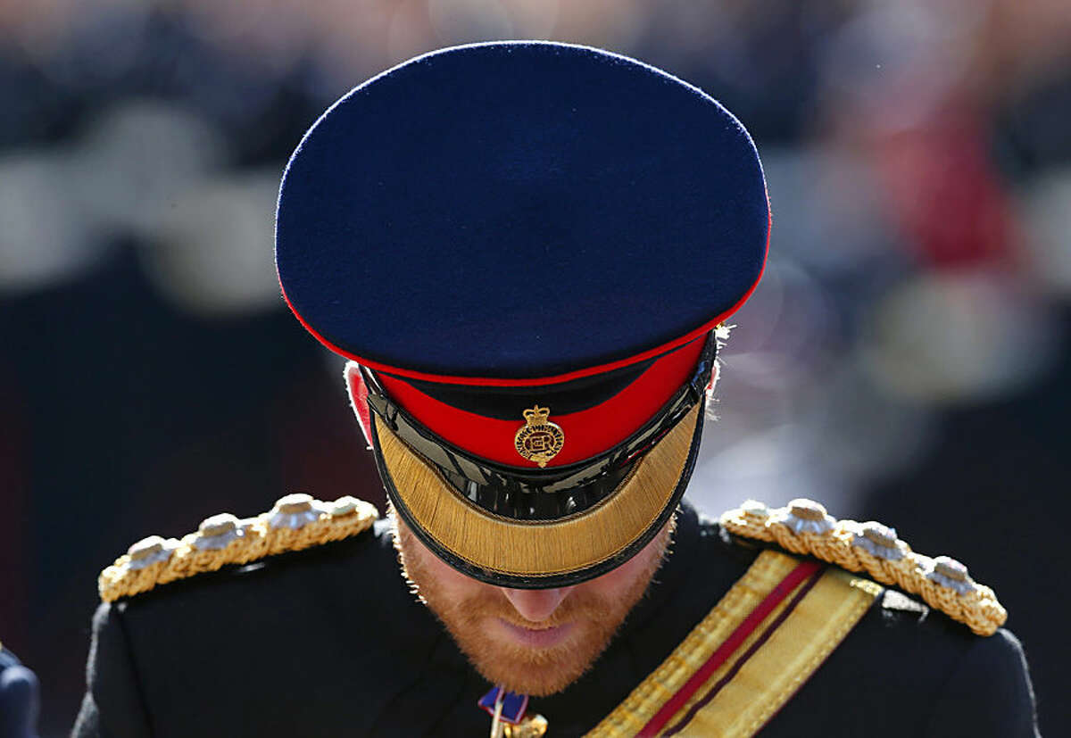 Britain's Prince Harry inspects student guards during his visit to The Duke of York's Royal Military School in Dover, southern England, Monday, Sept. 28, 2015. (Eddie Keogh/Pool Photo via AP)