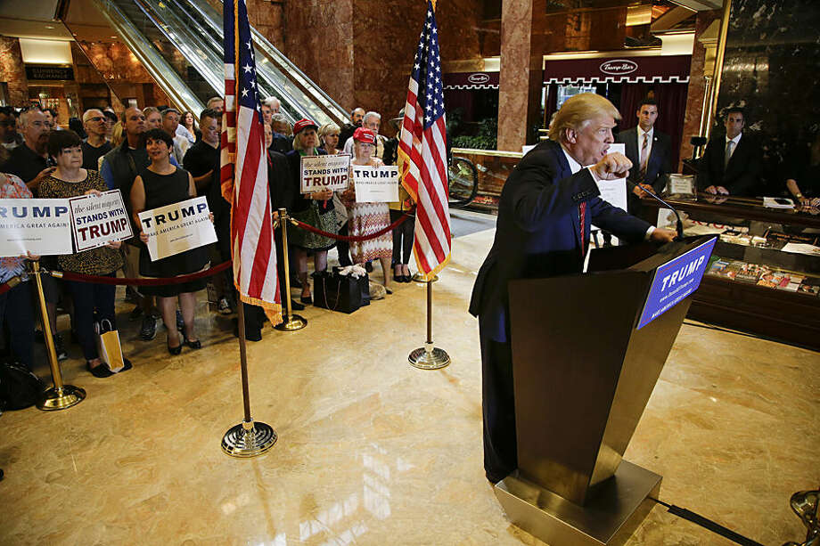 Republican presidential candidate Donald Trump talks about his tax plan during a news conference, Monday, Sept. 28, 2015, in New York. The Republican front-runner is calling for an overhaul of the tax code that would eliminate income taxes for millions of Americans, while lowering them for the highest-income earners and business.(AP Photo/Julie Jacobson)