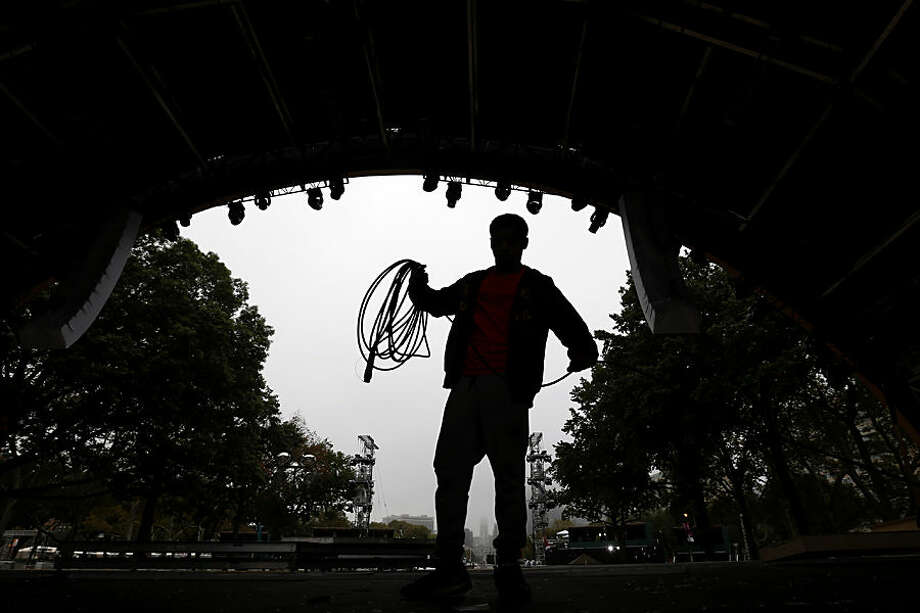 A man collects cable while cleaning up the stage where Pope Francis celebrated Sunday Mass during the cleanup process along Benjamin Franklin Parkway, in Philadelphia, Monday, Sept. 28, 2015, a day after the pope concluded his 10-day trip to Cuba and the United States. (AP Photo/Julio Cortez)