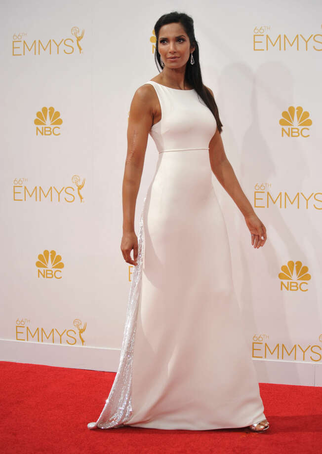Padma Lakshmi arrives at the 66th Annual Primetime Emmy Awards at the Nokia Theatre L.A. Live on Monday, Aug. 25, 2014, in Los Angeles. (Photo by Richard Shotwell/Invision/AP)