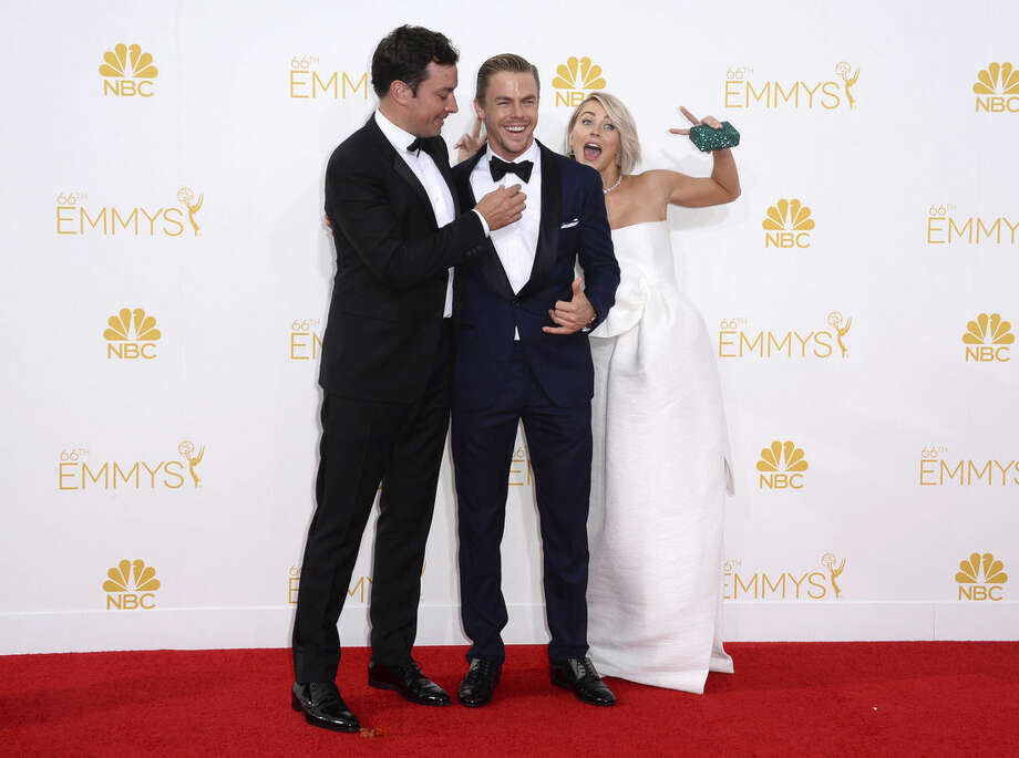 Jimmy Fallon, from left, Derek Hough and Julianne Hough arrive at the 66th Annual Primetime Emmy Awards at the Nokia Theatre L.A. Live on Monday, Aug. 25, 2014, in Los Angeles. (Photo by Jordan Strauss/Invision/AP)
