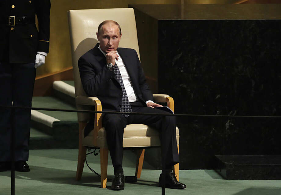 Russia's Vladimir Putin waits to begin his address to the 70th session of the United Nations General Assembly, Monday, Sept. 28, 2015. (AP Photo/Richard Drew)