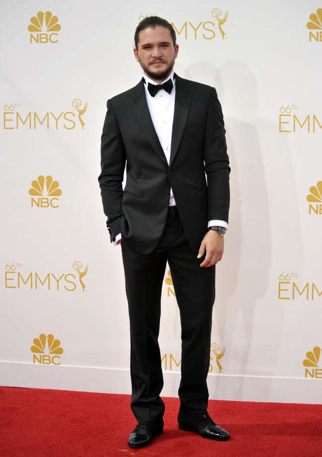 Kit Harington arrives at the 66th Annual Primetime Emmy Awards at the Nokia Theatre L.A. Live on Monday, Aug. 25, 2014, in Los Angeles. (Photo by Richard Shotwell/Invision/AP)
