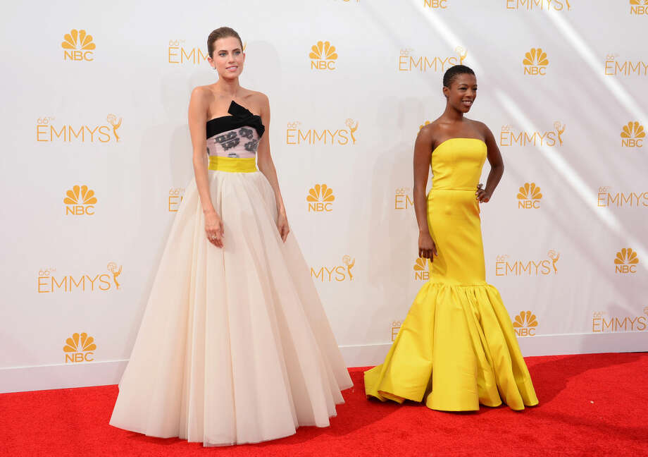 Allison Williams, left, and Samira Wiley arrive at the 66th Annual Primetime Emmy Awards at the Nokia Theatre L.A. Live on Monday, Aug. 25, 2014, in Los Angeles. (Photo by Jordan Strauss/Invision/AP)