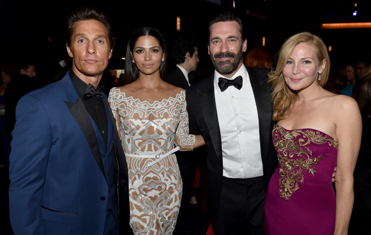 IMAGE DISTRIBUTED FOR THE TELEVISION ACADEMY - EXCLUSIVE - Matthew McConaughey, from left, Camila Alves McConaughey, Jon Hamm, and Jennifer Westfeldt pose at the 66th Primetime Emmy Awards at the Nokia Theatre L.A. Live on Monday, Aug. 25, 2014, in Los Angeles. (Photo by John Shearer/Invision for the Television Academy/AP Images)