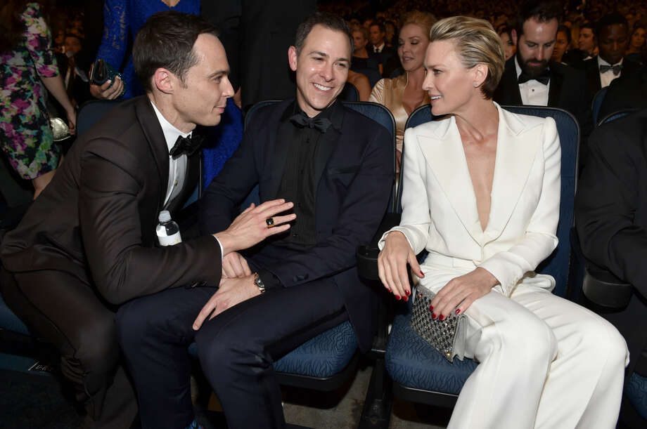 IMAGE DISTRIBUTED FOR THE TELEVISION ACADEMY - EXCLUSIVE - Jim Parsons, from left, Todd Spiewak, and Robin Wright pose at the 66th Primetime Emmy Awards at the Nokia Theatre L.A. Live on Monday, Aug. 25, 2014, in Los Angeles. (Photo by John Shearer/Invision for the Television Academy/AP Images)