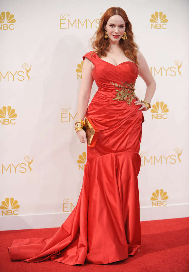 Christina Hendricks arrives at the 66th Annual Primetime Emmy Awards at the Nokia Theatre L.A. Live on Monday, Aug. 25, 2014, in Los Angeles. (Photo by Richard Shotwell/Invision/AP)