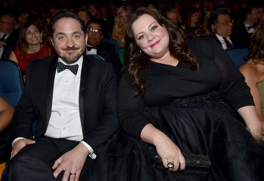 IMAGE DISTRIBUTED FOR THE TELEVISION ACADEMY - EXCLUSIVE - Ben Falcone, left, and Melissa Mccarthy pose at the 66th Primetime Emmy Awards at the Nokia Theatre L.A. Live on Monday, Aug. 25, 2014, in Los Angeles. (Photo by John Shearer/Invision for the Television Academy/AP Images)