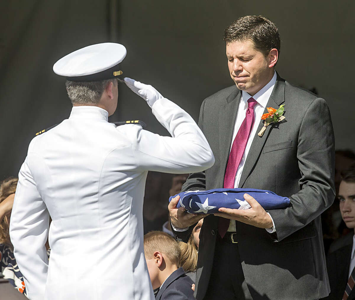 Lt. Cmdr. Johnathan Liddle salutes Michael W. Scott after presenting him with the flag during funeral services for Mormon leader Richard G. Scott in Salt Lake City, Monday, Sept. 28, 2015. Scott died Sept. 22 from natural causes at the age of 86. (Scott G Winterton/The Deseret News via AP) SALT LAKE TRIBUNE OUT; MAGS OUT; MANDATORY CREDIT; TV OUT