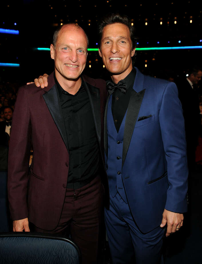 IMAGE DISTRIBUTED FOR THE TELEVISION ACADEMY - EXCLUSIVE - Actors Woody Harrelson, left, and Matthew McConaughey in the audience at the 66th Primetime Emmy Awards at the Nokia Theatre L.A. Live on Monday, Aug. 25, 2014, in Los Angeles. (Photo by Frank Micelotta/Invision for the Television Academy/AP Images)