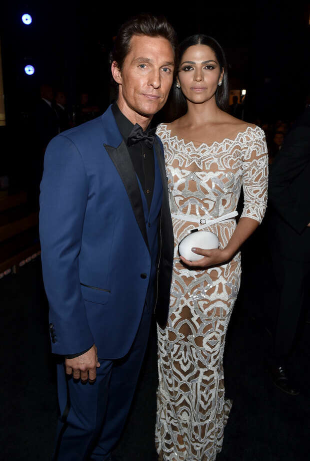 IMAGE DISTRIBUTED FOR THE TELEVISION ACADEMY - EXCLUSIVE - Matthew McConaughey, left, and Camila Alves McConaughey pose at the 66th Primetime Emmy Awards at the Nokia Theatre L.A. Live on Monday, Aug. 25, 2014, in Los Angeles. (Photo by John Shearer/Invision for the Television Academy/AP Images)