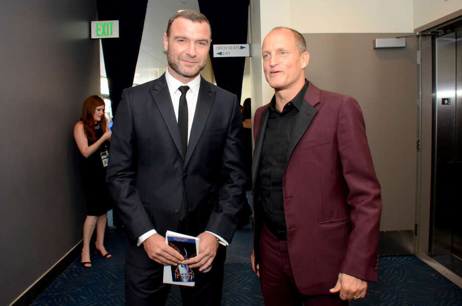 IMAGE DISTRIBUTED FOR THE TELEVISION ACADEMY - EXCLUSIVE - Liev Schreiber, left, and Woody Harrelson pose at the 66th Primetime Emmy Awards at the Nokia Theatre L.A. Live on Monday, Aug. 25, 2014, in Los Angeles. (Photo by Tonya Wise/Invision for the Television Academy/AP Images)