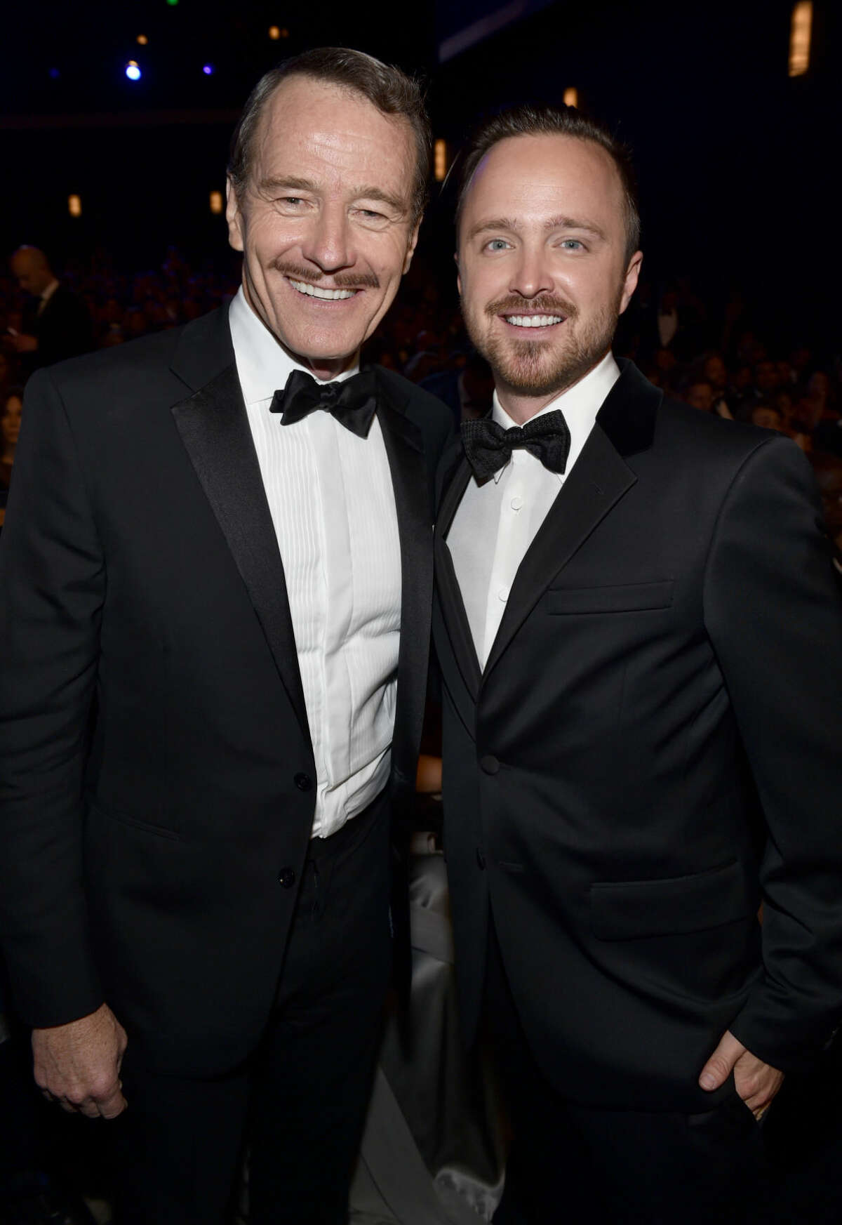 IMAGE DISTRIBUTED FOR THE TELEVISION ACADEMY - EXCLUSIVE - Bryan Cranston and Aaron Paul pose at the 66th Primetime Emmy Awards at the Nokia Theatre L.A. Live on Monday, Aug. 25, 2014, in Los Angeles. (Photo by John Shearer/Invision for the Television Academy/AP Images)