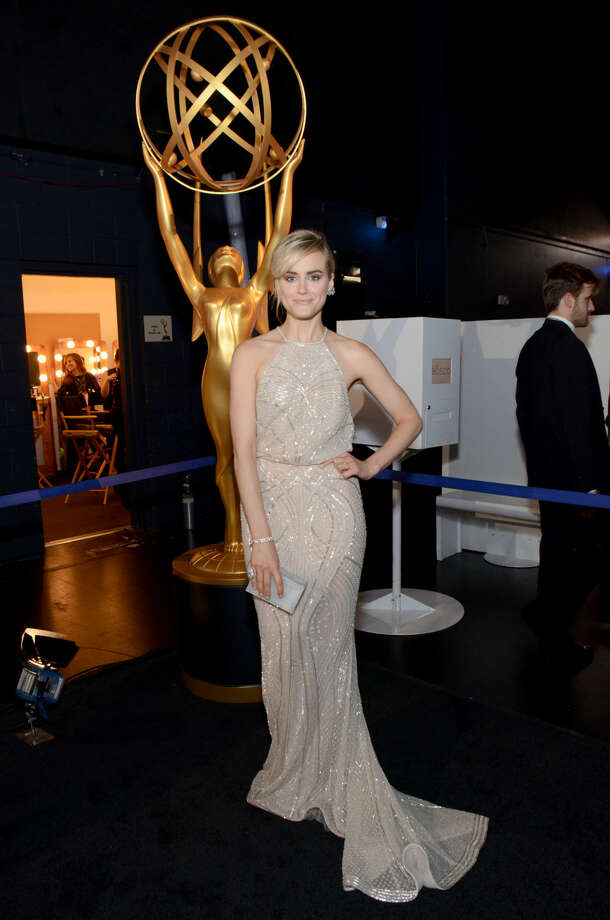 IMAGE DISTRIBUTED FOR THE TELEVISION ACADEMY - EXCLUSIVE - Taylor Schilling poses at the 66th Primetime Emmy Awards at the Nokia Theatre L.A. Live on Monday, Aug. 25, 2014, in Los Angeles. (Photo by Tonya Wise/Invision for the Television Academy/AP Images)