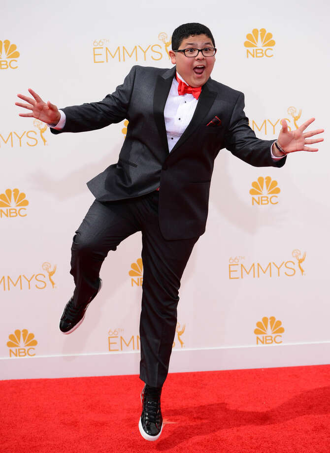 Rico Rodriguez arrives at the 66th Annual Primetime Emmy Awards at the Nokia Theatre L.A. Live on Monday, Aug. 25, 2014, in Los Angeles. (Photo by Jordan Strauss/Invision/AP)