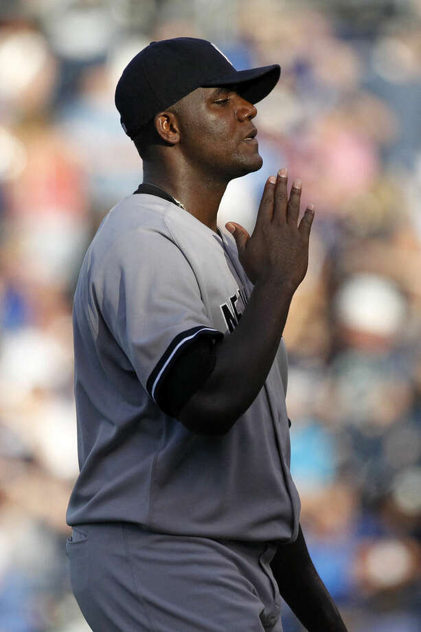 New York Yankees pitcher Michael Pineda walks to the mound in the first inning of a baseball game against the Kansas City Royals at Kauffman Stadium in Kansas City, Mo., Monday, Aug. 25, 2014. (AP Photo/Colin E. Braley)