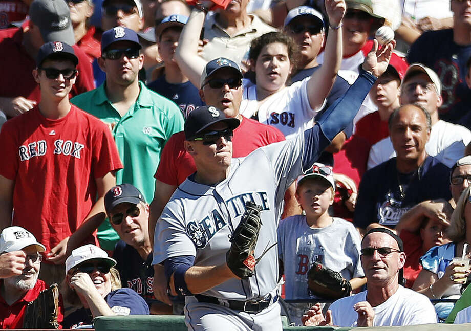 Seattle Mariners' Logan Morrison throws in to cover home plate on a pop foul by Boston Red Sox's Christian Vazquez in the third inning of a baseball game in Boston, Sunday, Aug. 24, 2014. (AP Photo/Michael Dwyer)