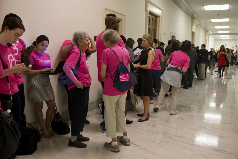 "Supporters and opponents of Planned Parenthood line up on Capitol Hill in Washington, Tuesday, Sept. 29, 2015, hoping to attend the House Oversight and Government Reform Committee hearing on ""Planned Parenthood's Taxpayer Funding."" (AP Photo/Jacquelyn Martin)"
