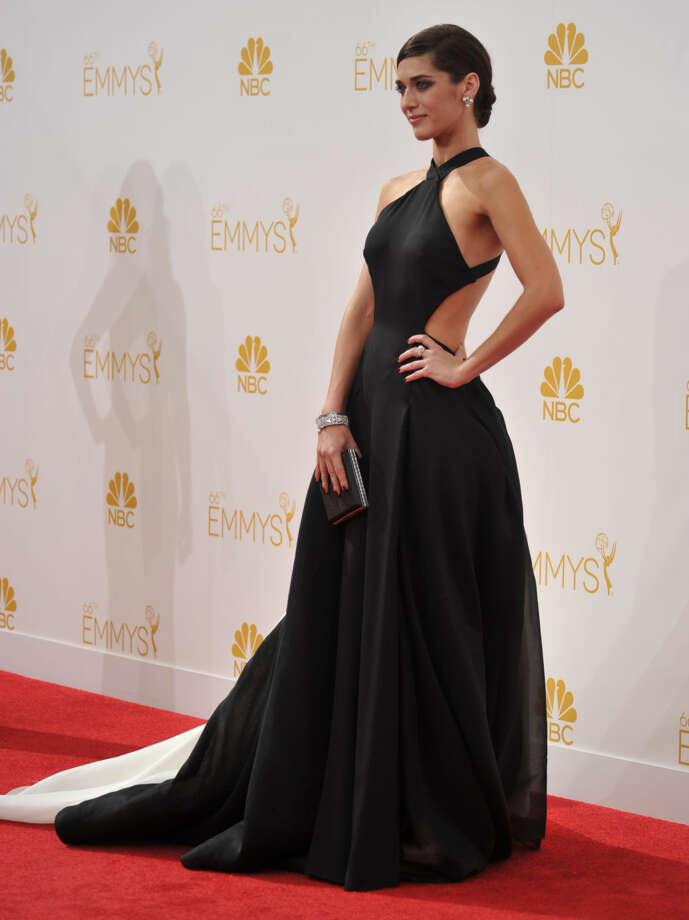 Lizzy Caplan arrives at the 66th Annual Primetime Emmy Awards at the Nokia Theatre L.A. Live on Monday, Aug. 25, 2014, in Los Angeles. (Photo by Richard Shotwell/Invision/AP)