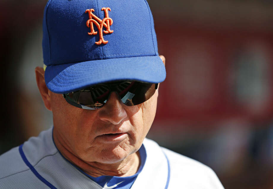 New York Mets manager Terry Collins looks on from the dugout prior to a baseball game against the Cincinnati Reds, Sunday, Sept. 27, 2015, in Cincinnati. The Mets won 8-1. (AP Photo/Aaron Doster)
